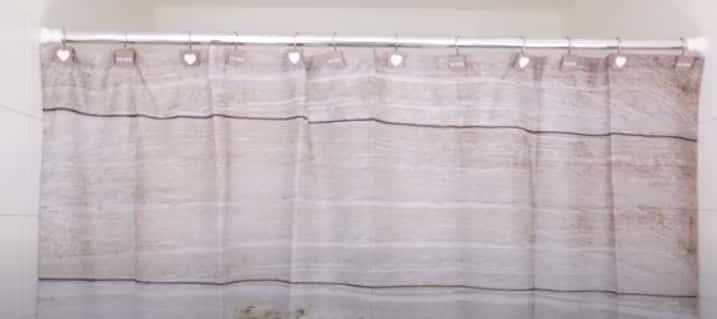 Installing ceramic shower curtain rod